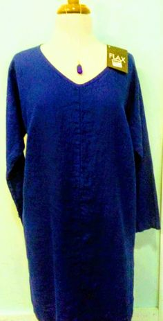 """BEST PRICE! WAS $88    Cobalt blue, long-sleeved knee-legnth tunic dresswith pockets and scoop neck, the comfort and wearibility makes this dress a stylish choice for your wardrobe.    Add seaglass and sterling necklace, handmade by Ocracoke artist Tara Gray, for more panache! (was $79)    Derived from the latin word meaning """"most useful,"""" the flax plant is a highly sustainable resource with fibers that make durable, soft and very easy-to-wear clothing. Touted for the style and comfort…"""