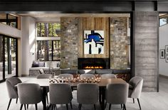 Martis-Dunsmuir House By sagemodern Interesting materials mix. Wood on fireplace and ceiling, Concrete column, tile floor, stone fireplace wall, Plaster walls.