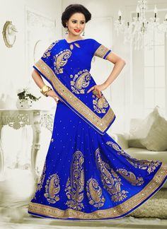 Be the dazzling diva clad in this blue georgette designer saree with exquisite designs and patterns. This pretty attire is showing some brilliant embroidery done with embroidered, patch border and zar...