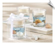 Clear-glass tea light holder with authentic seashells floating in ocean-blue gel make the perfect beach wedding favor accessory.