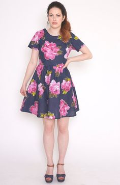 Mollie Brown cotton dress. Handmade from a light weight summer cotton fabric in navy with a large placement rose design. Fitted body with darts at ...