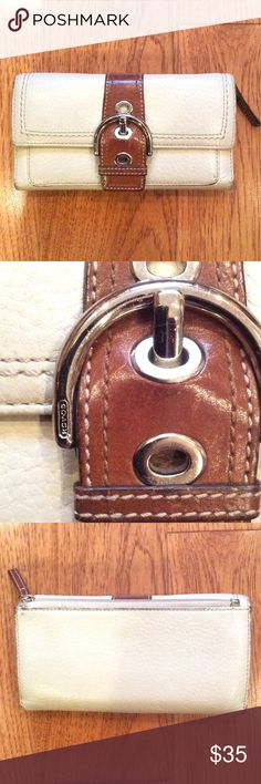 Coach Walllet Coach Wallet. Good used condition. Off white colored with brown details. The outside has some scuffs, especially on the edges. The coin area has some stains inside. The leather in the inside still looks almost new. Coach Bags Wallets