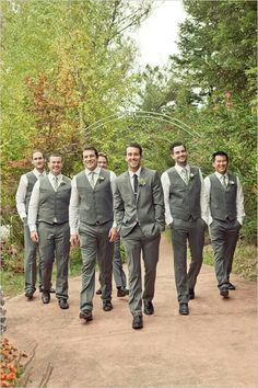 Grey suits are my favorite, and I like the idea of having the groomsmen wear vests and only having the groom in a jacket