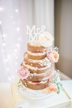 A naked cake with all the pizazz: http://www.stylemepretty.com/destination-weddings/2015/08/10/spring-inspired-rustic-chic-uk-wedding/ | Photography: Sarah-Jane Ethan - http://sarahjaneethan.co.uk/