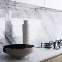 White marble backsplash and quartz counter by Greg Natale