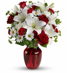 Send her a holiday bouquet from Morning Glory Florist at 1721 Grant Ave, Novato, CA.   http://shoplocalnovato.com/business/morning-glory-florist/