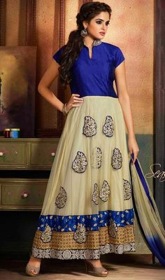 Chance on a twist of grace draped in this cream and royal blue net silk long Anarkali churidar suit. This enticing dress is displaying some brilliant embroidery done with lace, patch and resham work.  #RoyalBlueAndCreamPatchWorkAnkleAnarkali