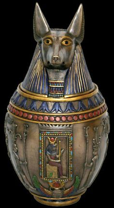 Egyptian Canopic Jar featuring Anubis  from 13 Moons. I want this so much! It is amazing! They also have a Bastet one.