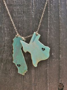 Live amp; Love Custom Necklace. You pick the States or Countries and the Cities that the hearts are placed in. via Etsy