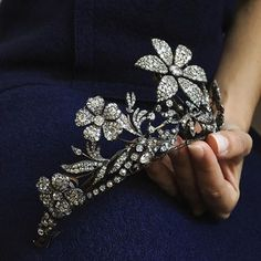 Charming 19th century diamond tiara. The central flowerhead dates back to 1780, the remaining tiara was made in 1820. Important Jewels, London 30 November.
