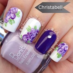 I filmed a little 'Behind the Scenes' video featuring these pretty purple flowers  YouTube link in bio   Polishes Used: @bonitacolors Purple Pop, Purple Art and Lilac Fields, Motives Wedding Dress (white), and @colour gossip nails Eco Friendly (green). #floralnails #notd #Padgram