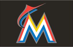 Miami Marlins Cap Logo (2012) - An orange and blue marlin leaping over a white, orange, yellow and blue M with a silver outline on black