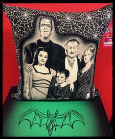 Throw pillow with glow in the dark webs on front and soils black backing.