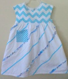 The Birthday Dress made from The Geranium Dress Pattern using Chevron and Batiste.  http://gigglesandbeans.com/2013/07/the-birthday-dress.html