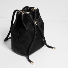 CONVERTIBLE BUCKET BAG WITH CORD ($40) ❤ liked on Polyvore featuring bags, handbags, shoulder bags, bucket bags, convertible purse, convertible shoulder bag, kieselstein-cord handbags and convertible handbag