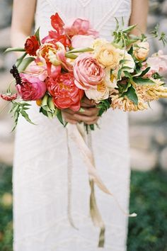 Citrus & blush peony bouquet with gold ribbons