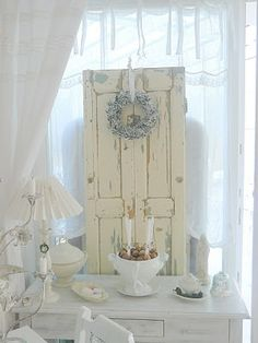Turn a boring side table in an unexpected pocket of beauty. White pain, A old panel (think junk yard or store), candles  and you're home free. I once took a lovely ceramic vase and filled it with a bouquet of tall, thin, narrow candles in various colors.