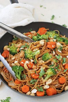 A simple broccoli carrot noodle stir-fry with a flavorful spicy soy sauce! Quick to make and so much better for you than takeout!