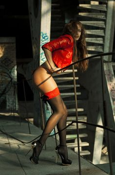 Red hot vest and stocking tops grest legs in black stockings!!