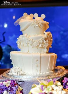 """Disney wedding cake: """"All white wedding cake with white chocolate bride + groom Mickey ears cake topper"""". Fancy Cakes, Cute Cakes, Beautiful Cakes, Amazing Cakes, Pastel Mickey, Disney Inspired Wedding, Disney Weddings, Disney Wedding Cakes, Disney Bride"""