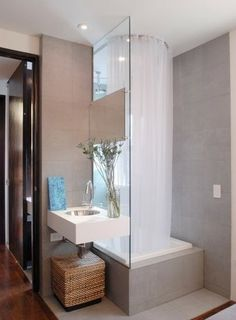 I am not sure how functional this would be for our spaces, but this is an interesting layout idea. shower and sink