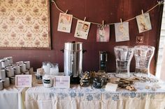 Rustic outdoor wedding at Paramount Ranch, with Coffee bar, vintage bridal ads, water dispensers, jars of snacks, and mustache mugs