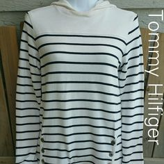 Tommy Hilfiger White / Navy Knit Hoodie Top Sz M Tommy Hilfiger White with Navy stripes knit top with a hoodie. 6 buttons on the front near the hem give thus light weight knit a Nautical look. Cute paired with jeans or shorts. No rips, tears or stains. Long sleeve. 100% cotton. Measurements: Ap-Ap- 17, Collar to hem- 23, Sleev- 23. Tommy Hilfiger Tops Sweatshirts & Hoodies