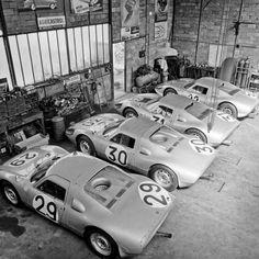 Porsche 904s. 2 4-cylinders, 2 6-cylinders. Le Mans Garages.