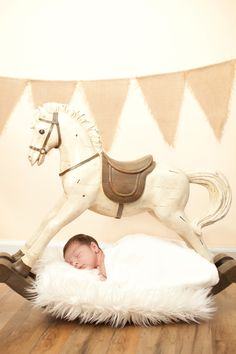 newborn boy with rocking horse Taken by Shoshannah May of Smiles and Memories Photography www.sandmphotos.wix.com/smile rocking horse, newborn, carousel horse, infants, newborn photography