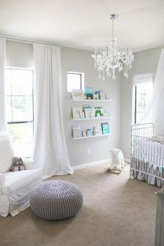 White grey cream nursery, chandelier, crib. The bookshelf is so cute, showing all the different books #interiordesign #nursery #homedecor