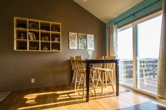 After home staging - Christi Hacker, Realtor, Keller Williams Greater Omaha - About - Google+. dining area, kitchen, cube shelf, art