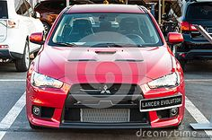 Photo about Front view of new modern Mitsubishi Lancer Evolution red car at auto salon. Image of fast, metal, luxury - 32703493 Car Editorial, Mitsubishi Lancer Evolution, Stock Photos, Cars, Luxury, Modern, Red, Image, Trendy Tree