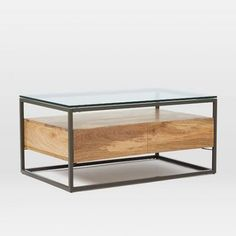 Made from richly-grained raw mango wood, our Box Frame Storage Coffee Table offers plenty of room for books, magazines and knickknacks with its glass top and open shelf.