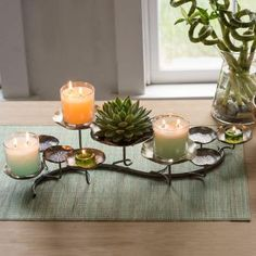 Product image of Lotus Centerpiece shown with lit candle