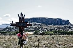 Roadside descansos/cross in front of Black Mesa, near Espanola, NM