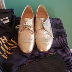 Gold Ted Baker Oxfords Flats! 8.5 US! Gorgeous Ted Baker Oxfords in Gold.  Beautiful goldtone metal accents on laces and back. Rubber soles.  Size 8.5 US.  Reposh as seller told me they were a 9.5. Light wear on these and a few scratches (picture of scratches on toe of shoe on the left in first picture).  Does not detract from beauty but instead gives them a gorgeous slightly distressed look.  Questions and reasonable offers welcome.  Thanks for looking! Ted Baker Shoes Flats & Loafers