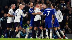 Chelsea's Branislav Ivanovic holds back Everton's James McCarthy as tempers flare during a Premier League match in London on Wednesday, February 11. Chelsea, the league leaders, won the home match 1-0.