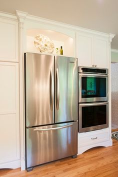 Love The Lighted Display Shelf Over The Refrigerator! Transitional Kitchen  By Renovations Group Inc