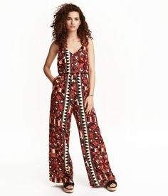 Check this out! V-neck jumpsuit in woven viscose fabric. Narrow adjustable shoulder straps, decorative opening at back, and elasticized seam at waist. Side pockets and straight, wide legs. - Visit hm.com to see more.