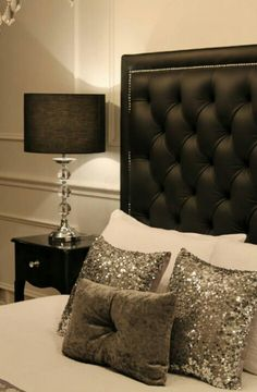 Love the sequined pillows. Black with silver accents.