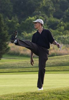 President Barack Obama puts a little body English on his shot during a round of golf at Farm Neck golf course during his vacation on Martha's Vineyard, Aug. 24, 2009. (Official White House Photo by Pete Souza)  Most iconic Pete Souza photos of Obama family's first 4 years in the White House
