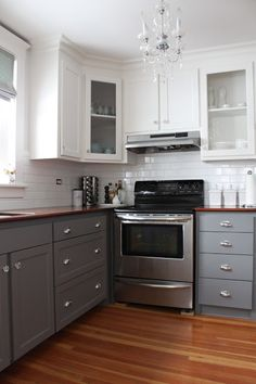 two-tone cabinets, thick crown molding above the cabinets, white subway tile