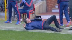 Manchester United manager Louis van Gaal mimicking a dive