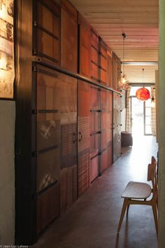 Cupboard doors are turned into a focal point thanks to clever use of reclaimed woods #bespoke #designer #storage #interiordesign #storageideas