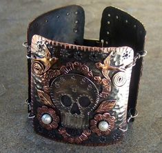 Sugar Skull cuff - I have some sturdy metallic crafting foil, that would make a lovely bracelet (doesn't have to be skulls, lol)