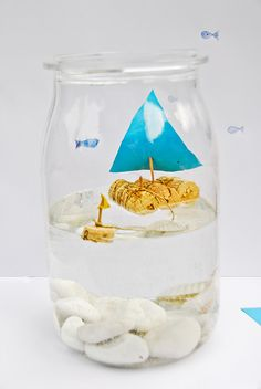 #DIY Cork Sailboat Aquarium in a jar. This is totally adorably and would look great in a little boy's bedroom or as an accent in a nautical living room.