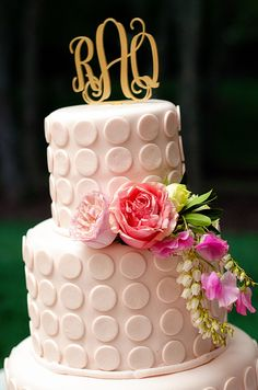 white wedding cake with pink floral accents and gold monogram cake topper at kate spade inspired outdoor garden wedding | Simply Charming Socials | Atlanta Wedding Planner