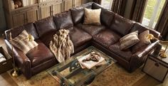 Im pretty much obsessed with brown leather sectionals.