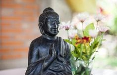 How To Decorate with the Water Feng Shui Element: Buddha Statue in Black