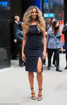 Va-voom: When Ciara arrived at the GMA studios she had on a tight black cocktail dress with a slit up her left leg and strappy patent leather heels that made the post of her toned legs
